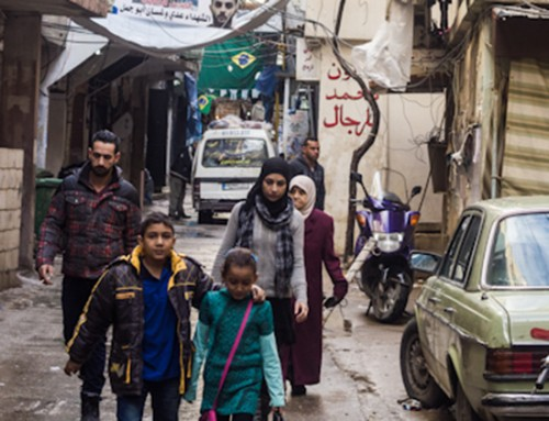 Residents of a Palestinian refugee settlement walking. Source: Jason Lemon